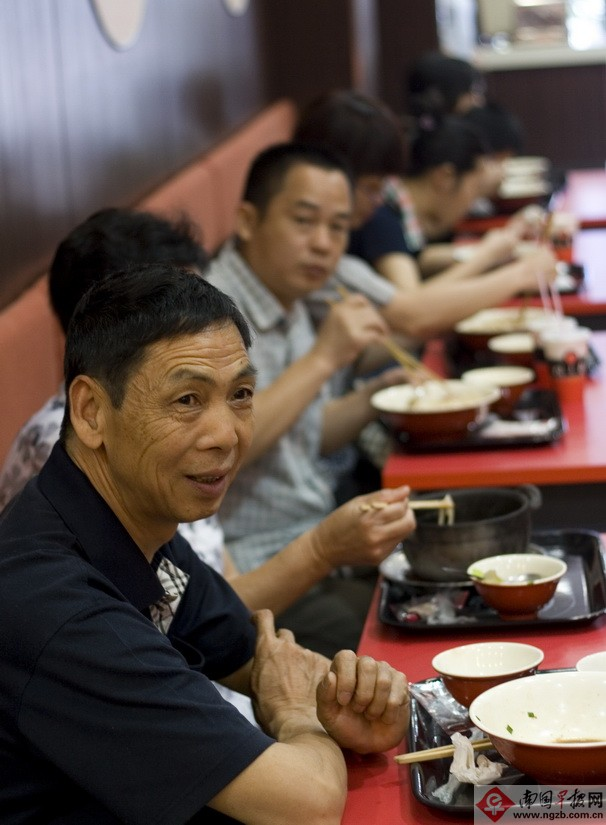 Uncle Who just finish his dish, seems quite happy.