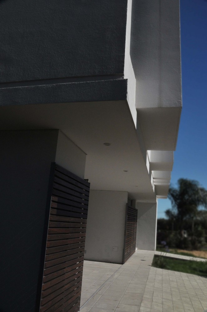 Vivienda en Country Funes Hills Cadaques - Martín Guarneri + Jose Rabasedas Arquitectos