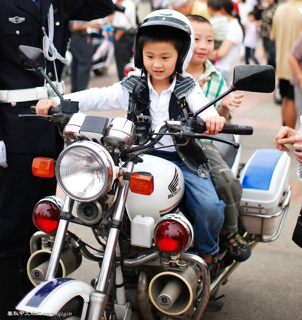 a kid is ridding a police motor