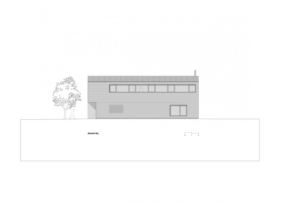 Casa de madera con patio interior - DI Bernardo Bader